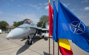 a_cf-188_fighter_jet_of_the_royal_canadian_air_force_on_display_during_the_ceremony_at_mihail_kogalniceau_airbase_romania