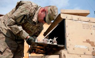 an_army_specialist_overhauls_a_generator_river_analytics