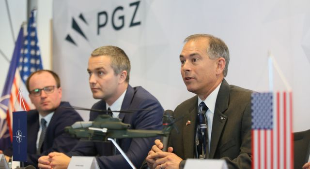 vice_president_of_international_military_business_for_bell_helicopter_rich_harris_right_with_pgz_representatives